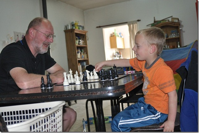 Joni and daddy playing chess