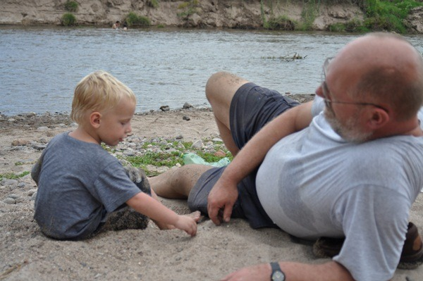 Playing on the river bank