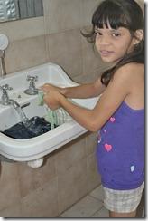 Child washing clothes