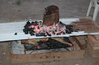 half a lamb on a fire