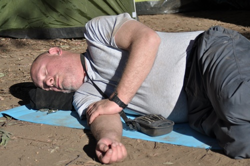 Martin asleep outside the tent