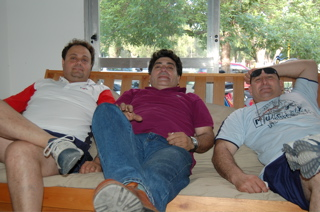 3 fat guys on a sofa