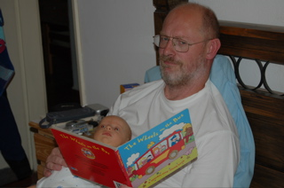 Martin reading a book with Joni