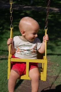 Joni on swing in plaza