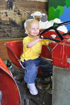 Joni riding tractor